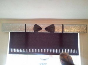 silver glitter with large black bow and ribbon